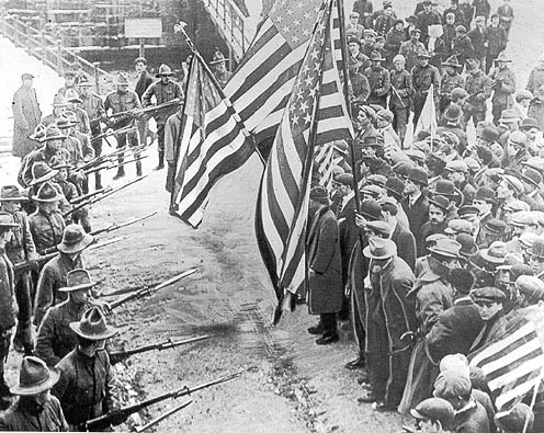 Militia aims bayonets at strikers in Lawrence, Mass. in 1912