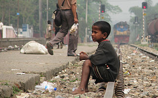 Street Child, Srimangal Railway Station, Srimangal, Maulvi Bazar, Bangladesh.  Photo by Md. Tanvirul Islam.