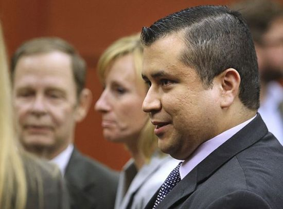 George Zimmerman leaves court with his family after Zimmerman's not guilty verdict was read in Seminole Circuit Court in Sanford, Florida, July 13, 2013.