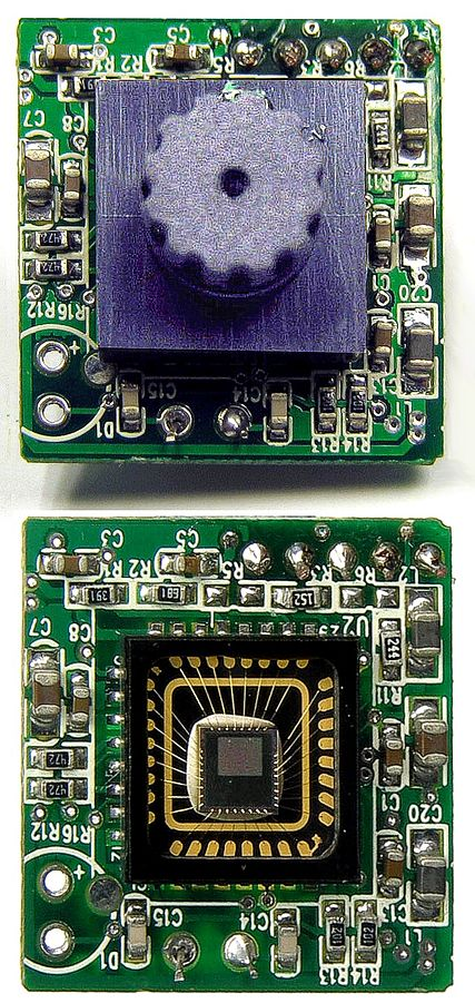 "The caption on http://en.wikipedia.org/wiki/Webcam says ""Webcams typically include a lens (shown at top), an image sensor (shown at bottom), and supporting circuitry."" ""Sweex USB webcam PCB with without lens close up"" by Original uploader was Mike1024 at en.wikipedia - Originally from en.wikipedia. Licensed under Public domain via Wikimedia Commons - http://commons.wikimedia.org/wiki/File:Sweex_USB_webcam_PCB_with_without_lens_close_up.jpg#mediaviewer/File:Sweex_USB_webcam_PCB_with_without_lens_close_up.jpg"""