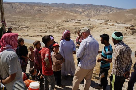 "Yazidi refugees and American aid workers on Mount Sinjar in August 2014"" USAID U.S. Agency for International Development - https://www.flickr.com/photos/usaid_images/14783000490"
