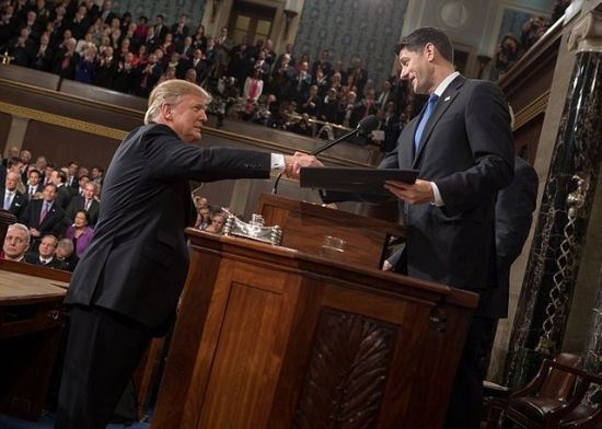 Donald Trump shaking hands with Speaker of the House Paul Ryan at his February 28, 2017 address to a joint session of Congress.