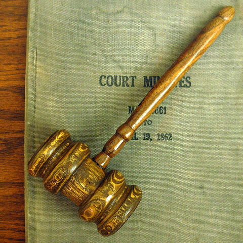 Old gavel and court minutes displayed at the Minnesota Judicial Center, photographed by Jonathunder, 2008-04-17.